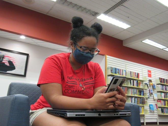 Aliyah Ferguson takes a break from her studies Oct. 25 at the Whetstone branch of the Columbus Metropolitan Library, 3909 N. High St. Ferguson, 23, is studying for her master's degree in education at Ohio State University and said she wants to be a fourth-grade teacher.