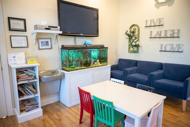 The lobby offers children a place to sit, read books, watch the fish and play at the Lake Sumter Children's Advocacy Center in Leesburg. [Cindy Peterson/Correspondent]