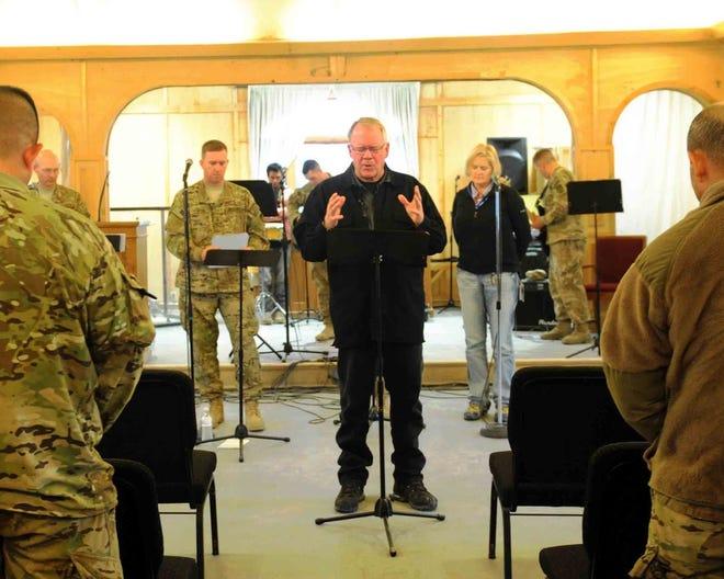 Pastor Stu Weber, center, offers an invocation during a national prayer event held at Kandahar Airfield's Fraise Chapel, in Kandahar province, Afghanistan, Feb. 3, 2013. Weber is speaking at Leesburg's Sept. 11 community prayer breakfast.