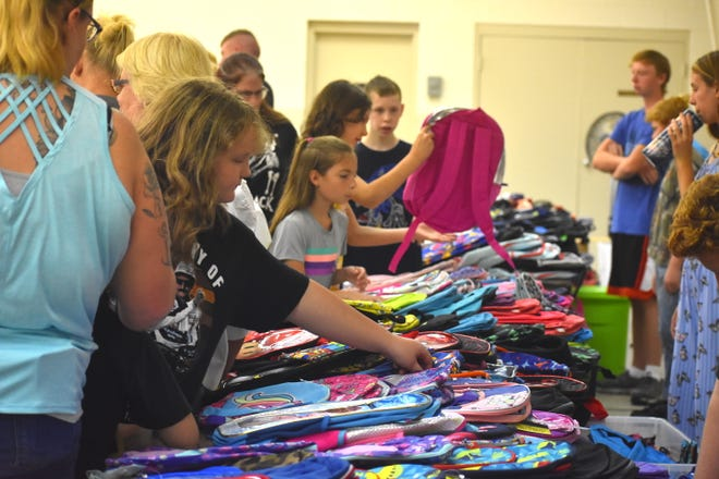 The fifth annual Backpacks for Children school supply drive, coordinated by Fairfield Township resident Bonnie Glisson, took place Saturday at the Fairfield Baptist Church. More than 1,200 backpacks and a plethora of school supply items were available for youth to select free of charge.