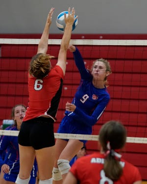 Lenawee Christian's Hannah Baker goes up for a kill during a match against Addison on Tuesday. [Telegram photo by Mike Dickie]