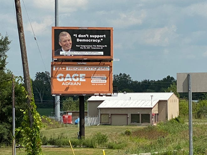 A billboard rented by 7th Congressional District Democrats to criticize U.S. Rep. Tim Walberg, R-Tipton, is pictured Tuesday along U.S. 223 near Ogden Highway.
