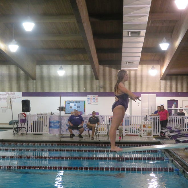 Burlington High School sophomore Hannah Wenzel prepares to dive Tuesday at the BHS pool.