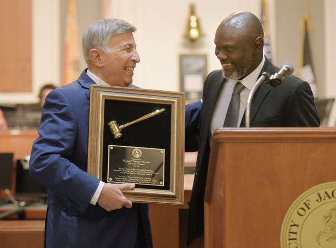 Tommy Hazouri, who died Saturday, served a one-year term as City Council president ending June 30. In this file photo, incoming council president Sam Newby gave Hazouri a gavel in recognition of his service.