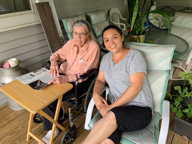 Gardner resident Thelma Earle, 98, is shown at home with one of her personal care assistants, Brenda Palma.