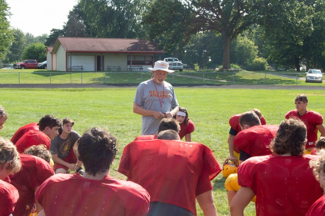 Reading head coach Rick Bailey talks to the team after a tough practice.