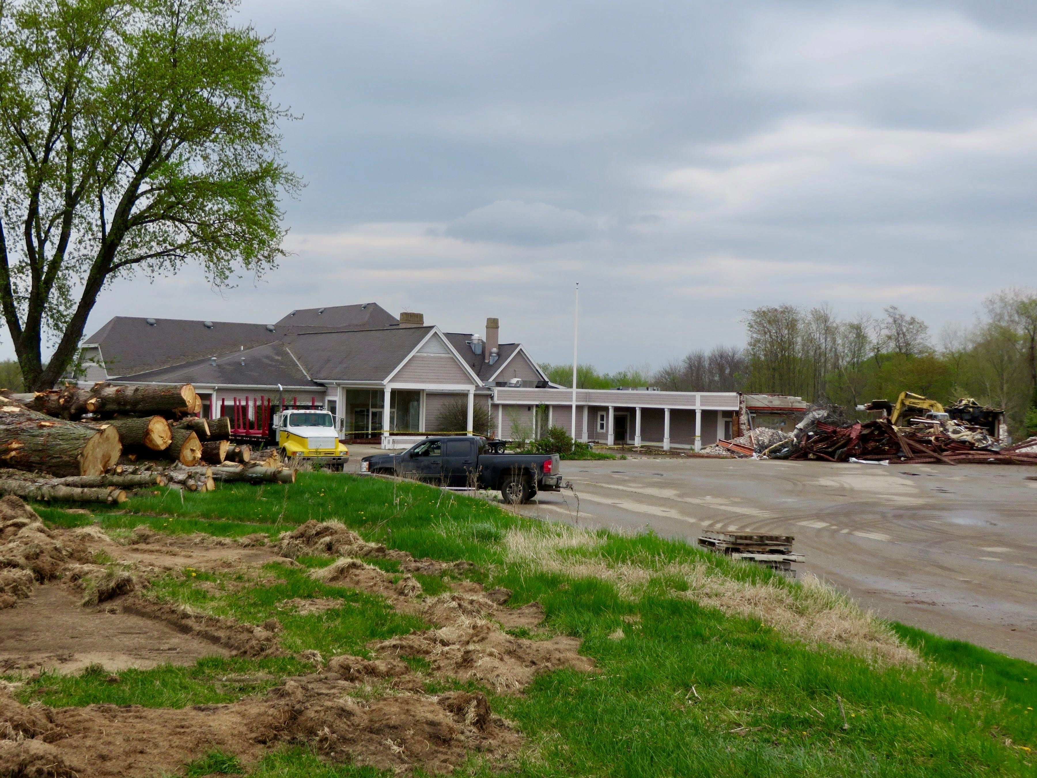 Demolition underway at Holland Country Club in 2014. By the date of its closure in 2009, the clubhouse had changed dramatically since the organization's first playing season in 1923.