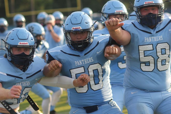 East Duplin center Jerson Ochoa (50) warms up with teammates before the Panthers' 67-6 win over Dixon on Monday.