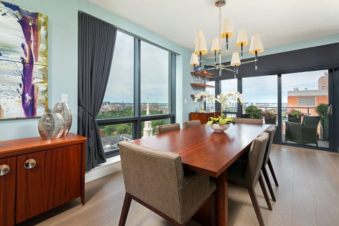 Almost 180 degrees worth of city views garner immediate attention in the dining area that is fully open to the kitchen and easily seats six, eight and more people.
