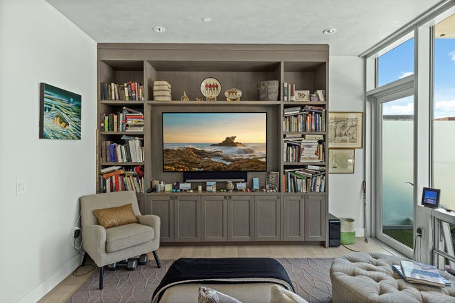 The medium-toned wood on the living room's built-in contrasts nicely with the pale hardwood flooring. There's room in the center for your TV.