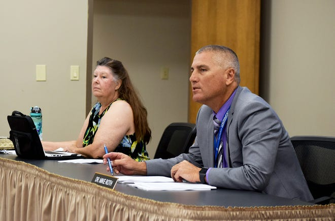 Superintendent Mike Roth, right, speaks Monday during a work session of the Leavenworth Board of Education. Also pictured is school board member Alisa Murphy. During the meeting, board members approved a lease agreement for the Pioneer Career Center property.