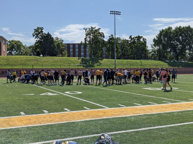 Shown are members of the University of Saint Mary football team gathering toward the end of practice