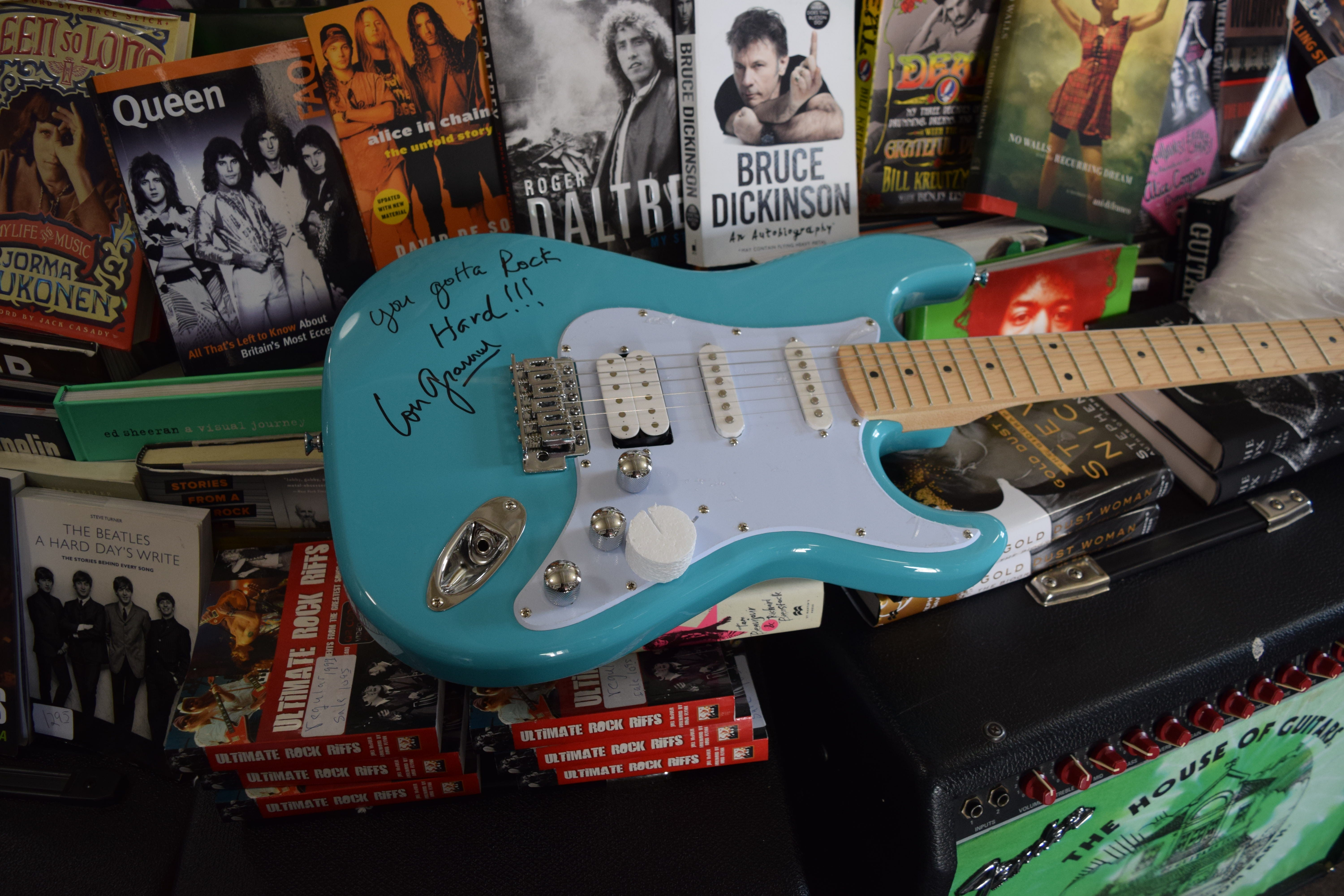 Guitar raffle benefiting Crime Stoppers, Locust Club
