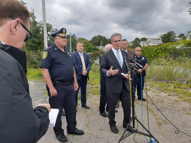 Worcester District Attorney Joseph Early speaks to the media last week after a man was found stabbed to death at a storage locker on Beach Street in Milford. The DA's Office announced Wednesday that an arrest has been made in connection with the case.