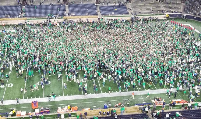 Notre Dame fans storm the field after the Irish upend No. 1 Clemson, 47-40 in overtime on Nov. 7, 2020, at Notre Dame Stadium.