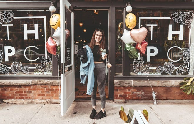 Elle Sherry stands at the entrance to The House Plant Co., a brand-new shop in Hamilton. They hosted their grand opening Aug. 21.