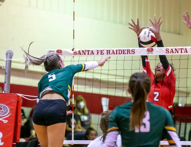 Forest outside hitter Emma Truluck (5) puts one by Santa Fe's Anisa Dorlouis during Tuesday's match in Alachua.