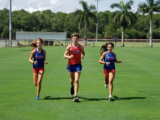 King's Academy cross country runners, left to right, Avery Fronrath, Colton Lawson and Mia Rodriguez, preparing for the upcoming season.