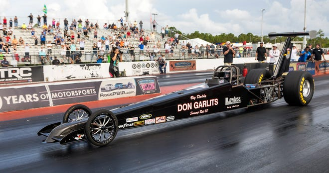"""Drag racing legend """"Big Daddy?"""" Don Garlits attempts to set a world speed record in his Swamp Rat 38 electric dragster Saturday at the Palm Beach International Raceway July 20, 2019. Garlits, the first man to break the 200-mph barrier in a Top Fuel dragster, was on a quest to reach the 200-mph milestone in a battery-powered dragster on the quarter-mile drag strip."""