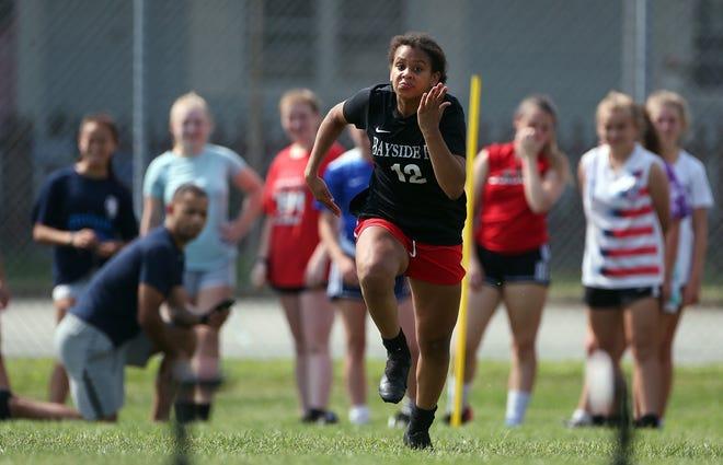 Amaya Coffie runs the 40-yard dash during a Pilgrim High School girls soccer practice this week.