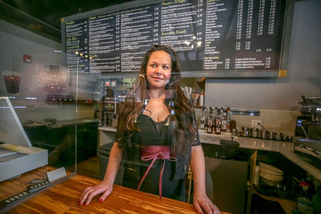 Natacha Legein, owner of Crêpe Corner in Cranston, is back behind the counter after nearly dying last September when a car hit her outside her bakery.