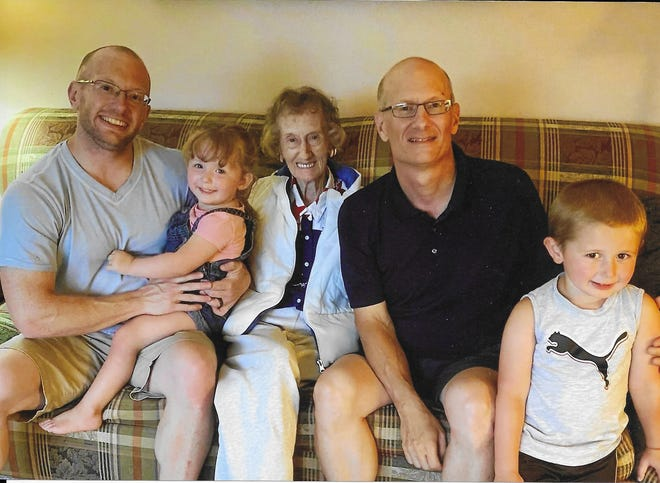 Barbara Moody, center, poses with her son, right, and grandson, left, and two great-grandchildren.