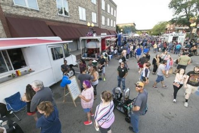 The 2019 Rock River Food Truck Fest, seen here on Aug. 24, 2019, drew hundreds of people to downtown Rockford for street food and music. The festival returns this weekend.