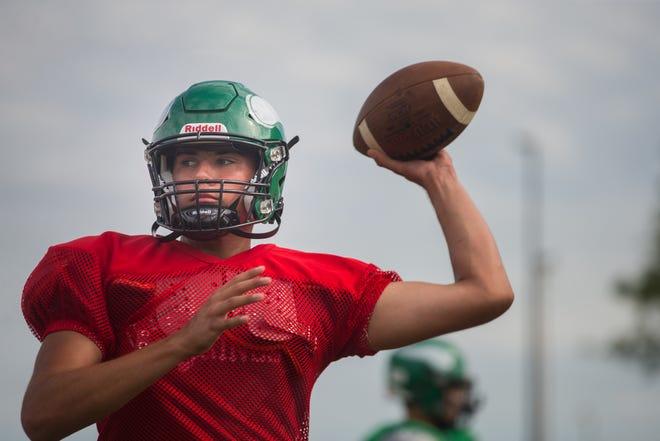 Quarterback Chandler Alderman runs drills on Wednesday, Aug. 25, 2021, at North Boone High School in Poplar Grove.