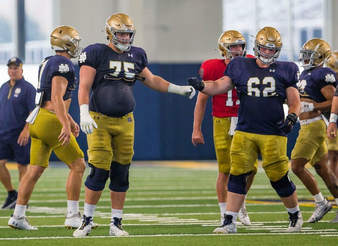 Tackle Josh Lugg (75) and offensive guard Cain Madden (62) during Notre Dame football practice, Wednesday, Aug. 25, 2021, at the Irish Athletics Center.