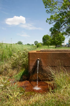 """This photograph is one of the photographs that will be included in the exhibit """"The Specialness of Springs - Work by Kay Westhues"""" through Sept. 10, 2021, at the Moreau Art Galleries at Saint Mary's College. The exhibit examines roadside springs in and near her home state of Indiana."""