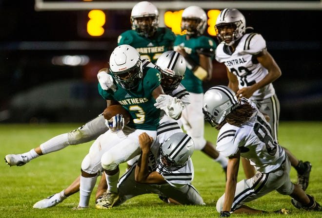 Leg cramps couldn't keep Washington senior Marshawn Lottie from doing what he could to ensure a 27-20 win over Hammond in the season opener.