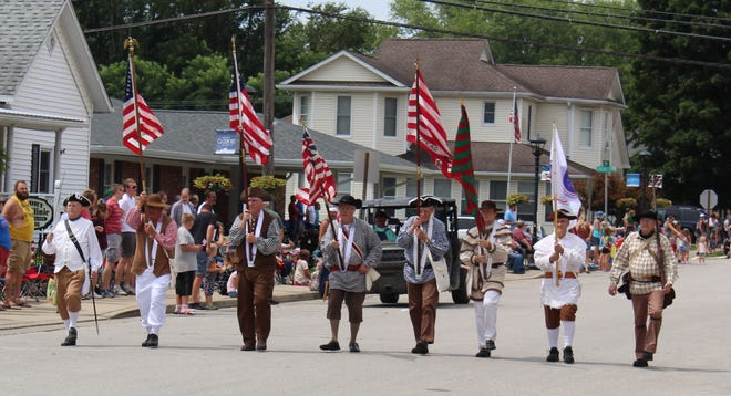 The color guard proudly displays the flags as they start the 2021 Gosport Lazy Days parade.