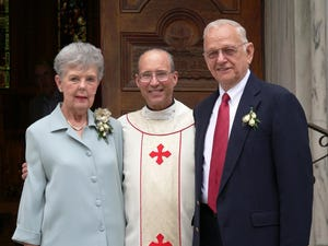 Joanne Koester celebrates her 50th wedding anniversary with her husband (right).