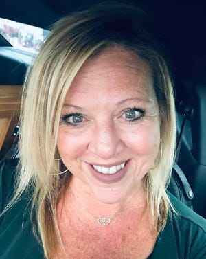 Sarasota teacher Michelle Cook died of COVID-19 this week.