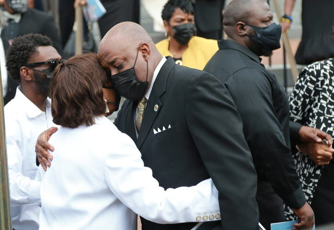 """Savannah Mayor Van Johnson offers his condolences to Gloria Stephens following the funeral for her husband Georgia House Representative Edward """"Mickey"""" Stephens Wednesday afternoon at the Cathedral Basilica of St. John the Baptist."""