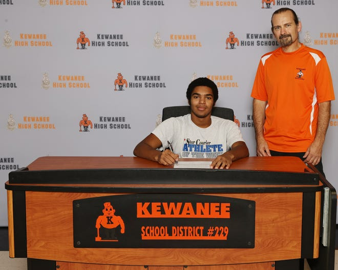 KHS athlete standout Melcon DeJesus Jr. signs a letter of intent to become a member of the Illinois State University track team in July, flanked by Kewanee Boys Head Track Coach Jeff King.