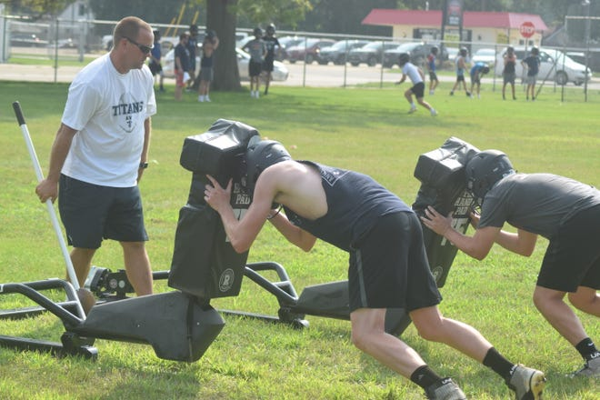 Tony Gripp, the new head coach of the Annawan-Wethersfield Titans, gives instructions to his squad during a recent practice. The team will take the field Friday for its season home opener.