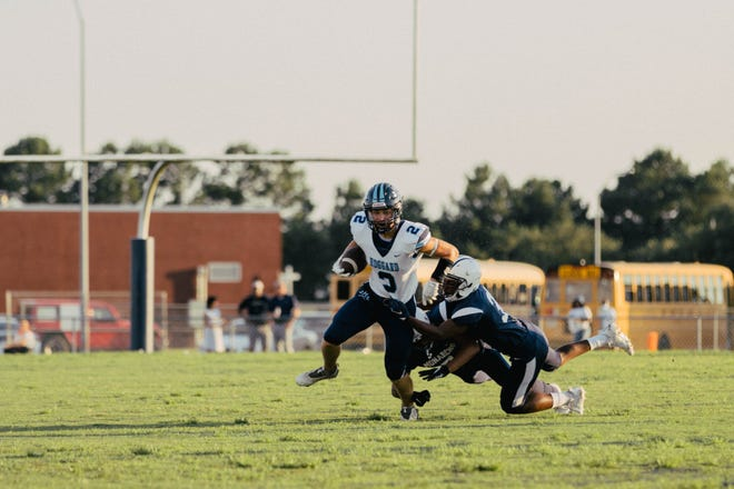 Hoggard's Conrad Newman tries to break a tackle during the Vikings' 28-0 win over Northside in Week 1.
