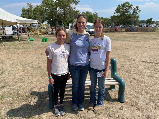 Top place winners in the women's division of the Super Farmer contest at The Brown County Fair were, from left, placing first Lona Krueger, of Stratford; in second, Cambry Dinger, of Britton, and in third, Taryn Thompson, of Groton. Participants competed in four events: bale throwing, pounding a fence post, maneuvering a wheel barrow through an obstacle course and hauling buckets of water.