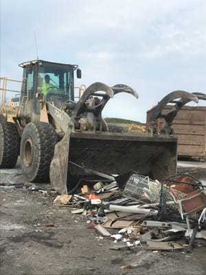 Jordon Sutton moves items around at the Brown County Landfill in advance of the fall cleanup, which begins Friday and continues through Sept. 11.