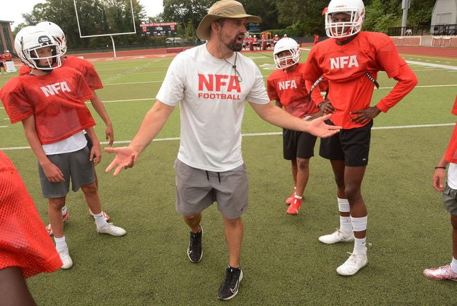 NFA head coach Jason Bakoulis talks to his players  during practice in Norwich.