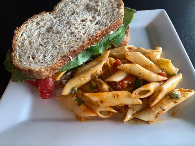 Cafe Quetzal's fresh veggie sandwich is packed with all the sandwich fixings including tomato, lettuce and cheese.
