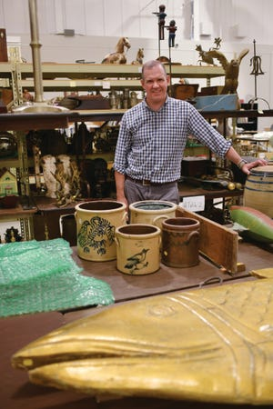 Christopher Barber, deputy director of American Furniture & Decorative Arts at Skinner, Inc., is pictured in Skinner's warehouse in Marlborough.