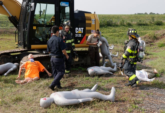 Victims of a simulated airplane crash are triaged during a drill held Wednesday at the Worcester Regional Airport. An excavator was used to simulate an aircraft that slid off of the runway. The Worcester Fire Department, Leicester and Paxton Fire Departments, Worcester EMS, the Massport Fire Department, and the Massachusetts State Police all participated in the drill.