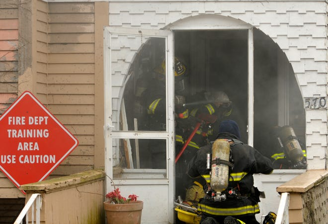 Worcester firefighters conduct a training exercise involving a distressed firefighter in the basement and a smoke-filled environment in February 2018.
