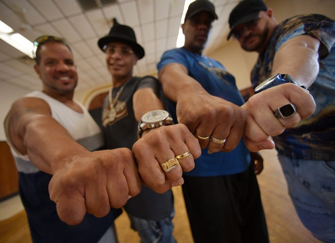 From left, hip-hop artists Francisco Torres (Mr. Sweet), Willie Martinez (Willie D.), Charles Safford (Chuck Chillin'), and Gino Figueroa visit the Arcadia Room above the White Eagle.