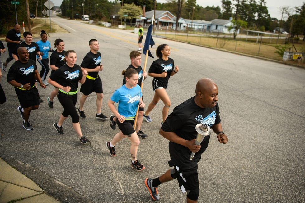 Spring Lake Police Chief Troy McDuffie leads the Special Olympics of North Carolina 2018 Law Enforcement Torch Run on Wednesday, April 4, 2018, in Spring Lake. [Andrew Craft/The Fayetteville Observer]