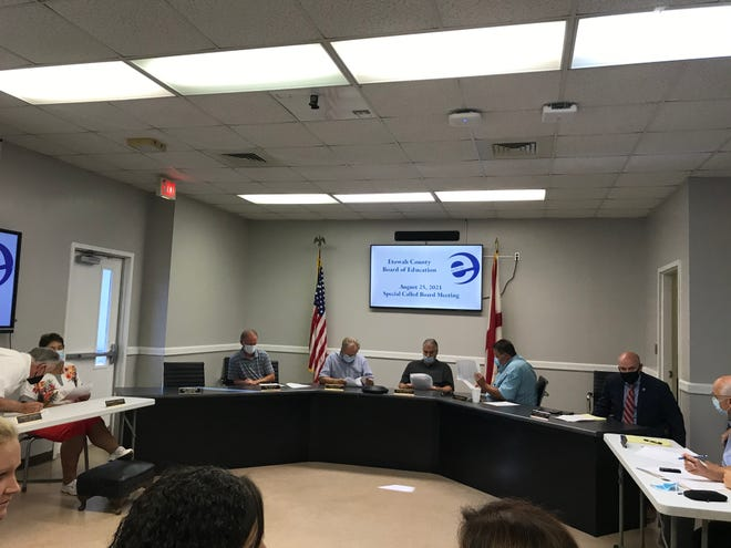 Members of the Etowah County School Board voted unanimously to require masks temporarily in schools to try to curb the rising number of COVID-19 cases.