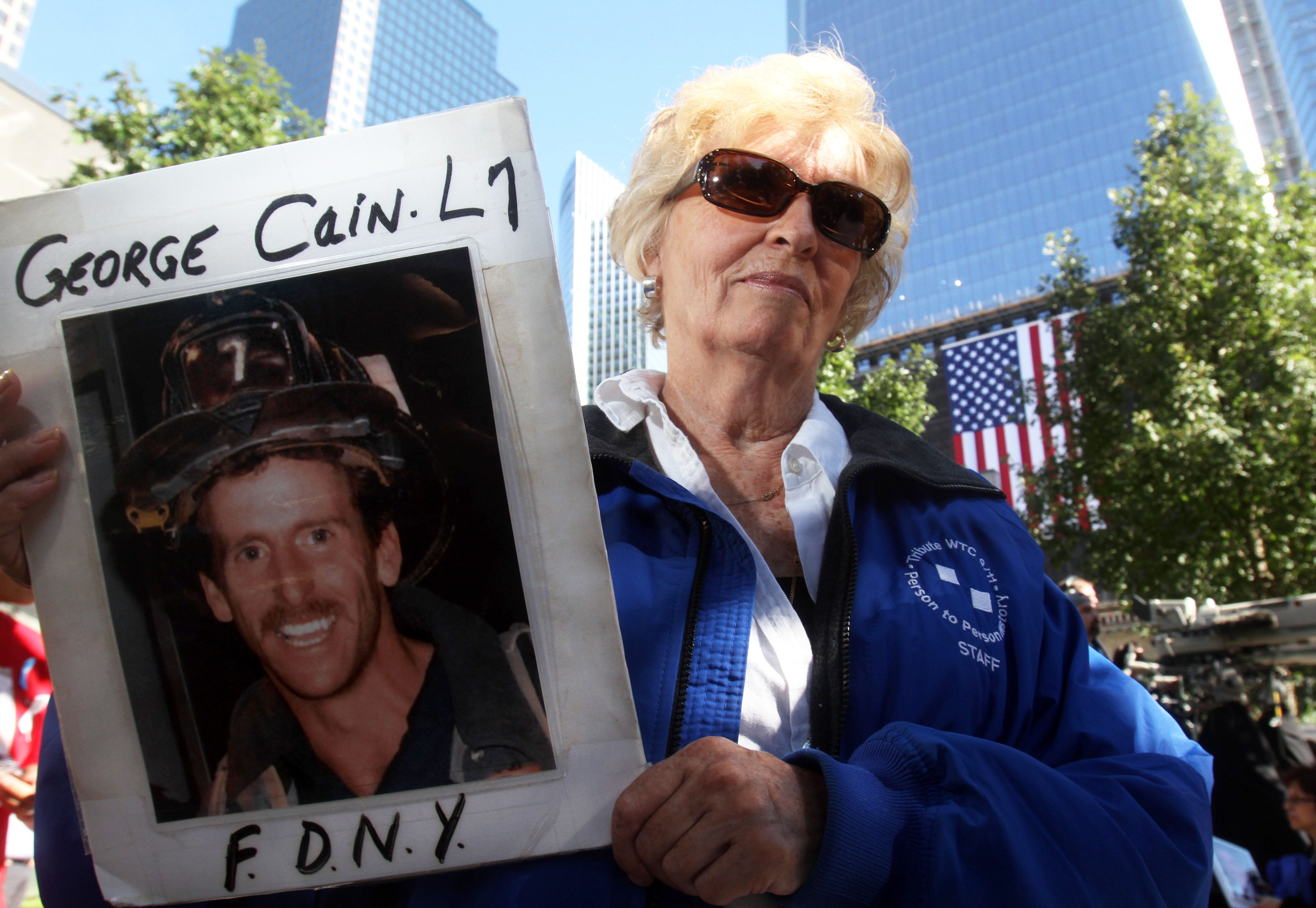 Rosemary Cain, of Massapequa, holds a photo of her son, New York City firefighter George Cain, a Patterson resident who was killed  Sept. 11, 2001. She was attending the annual ceremony at the World Trade Center.