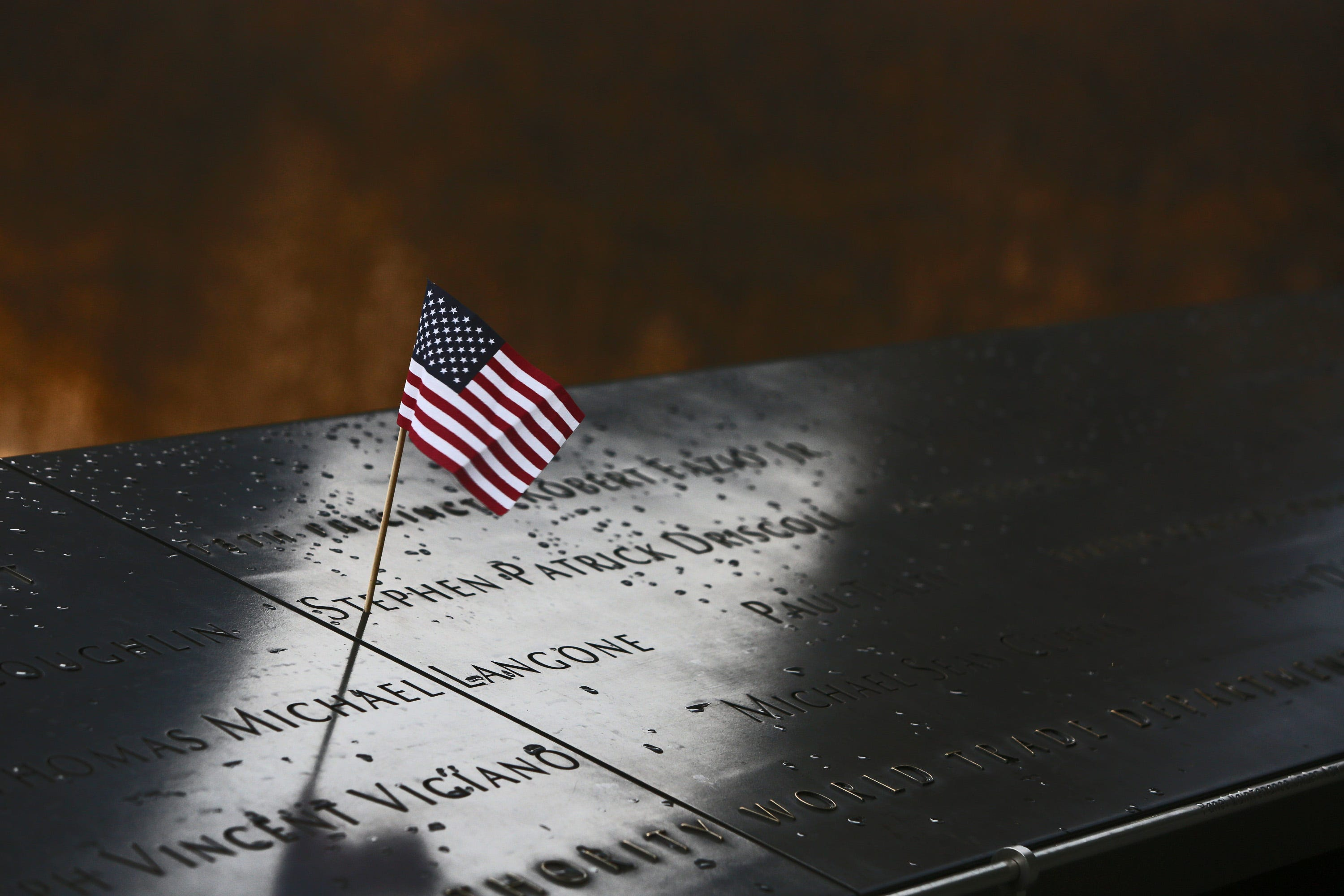 Names of people who died in the World Trade Center in the Sept. 11 terrorist attacks are engraved in bronze panels on parapets surrounding reflecting pools that are placed where the Twin Towers stood.